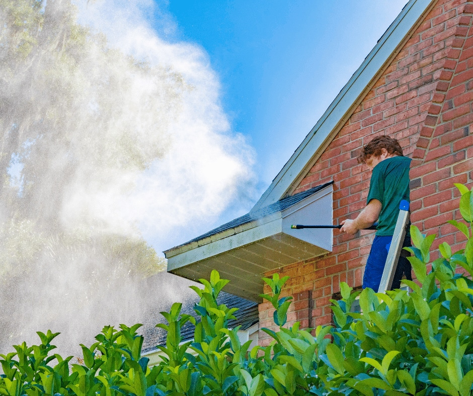 Pressure washing a residential House in McDonough, GA