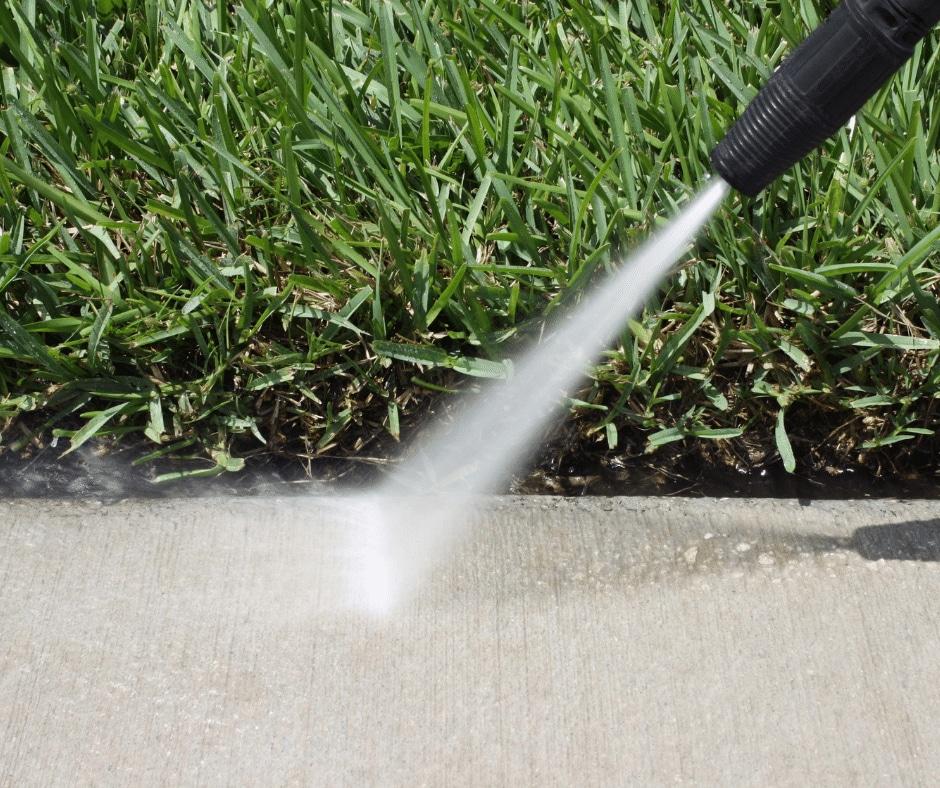 pressure washing a sidewalk